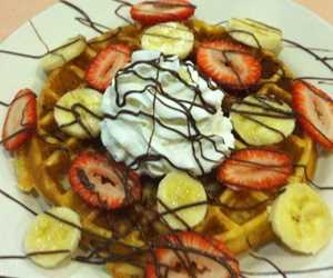 Belgian waffle with strawberries and bananas